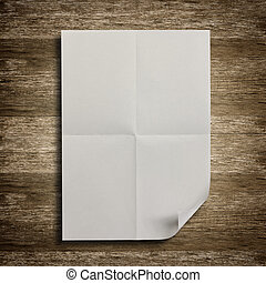 White paper on wood floor