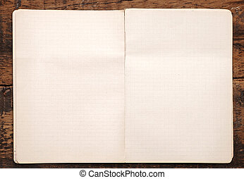 White paper pulled out from a notebook on a wood background
