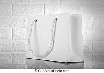 White Paper Shopping Bag on White Brick Background for ...