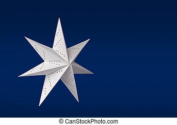 White paper star on blue