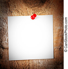 White paper sticky note reminder With red Push Pin on wooden old