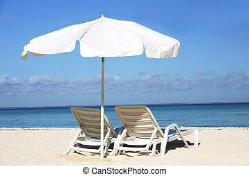 White Parasol - Single white parasol and sun lounger on...