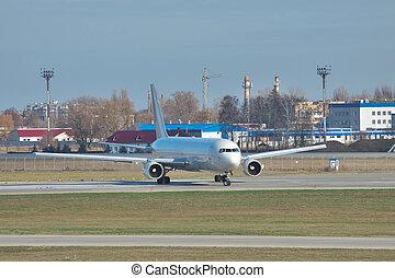 White passenger jet on runway