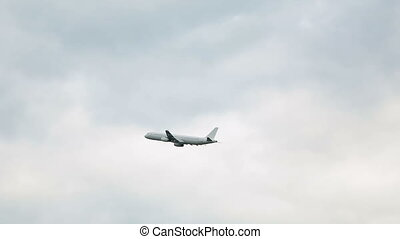 white passenger plane taking off from the airport