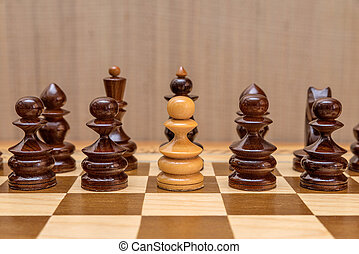White pawn standing in a row