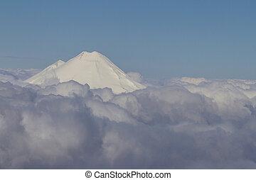 White peak in the clouds