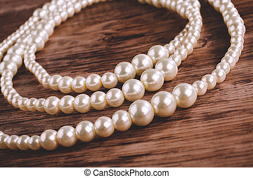 pearl necklace on a wooden background