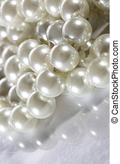 White pearl on reflective surface