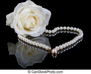 White pearls and rose - White pearl necklace and beautiful...