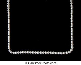 White pearls on the black velvet background