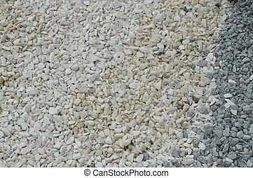 White pebble background with small round stones