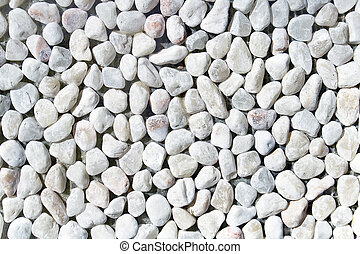 White pebble stones as background