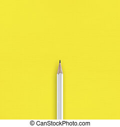 White pencil on yellow background top view