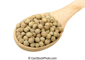 white pepper in a wooden spoon
