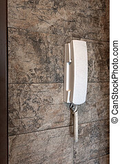 phone attached to a stone wall