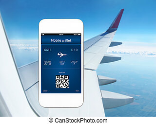 white phone with mobile wallet and plane ticket against the...