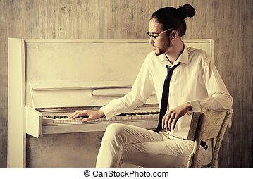 white piano - Musical concept. Pianist plays the piano.