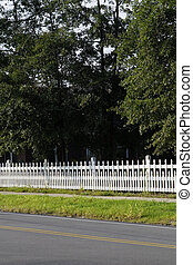 White Picket Fence Along A Road