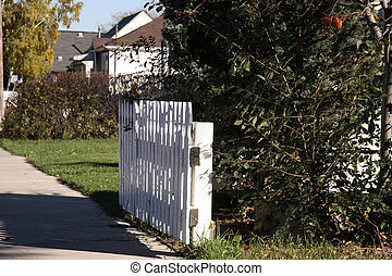 White picket fence in fro