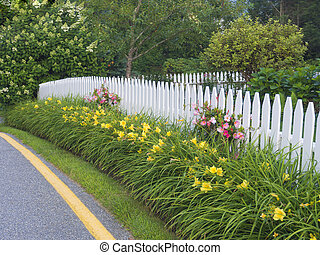 White picket fence in traditional garden