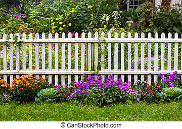 White Picket Fence - White picket fence with pretty flowers...