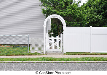 White Picket Fence - White fence sidewalk curb street