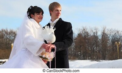 pigeon to sit down on shoulder to one of newly-married...