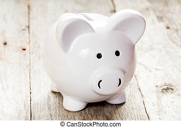 White piggy bank on wooden floor