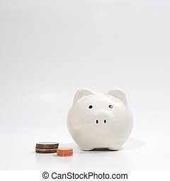 White piggy bank with coins.
