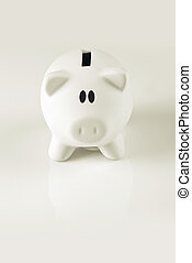 White Piggy coin bank for money savings, financial security or personal funds concept.