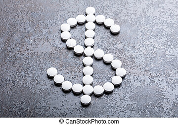 White Pills In The Shape Of A Dollar Sign