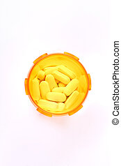White pills in yellow container, top view.
