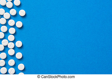 pills on blue background