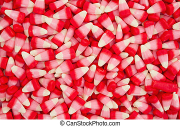White, pink and red candy corn background