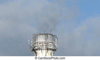 white pipe plant smoke black against blue sky environmental...