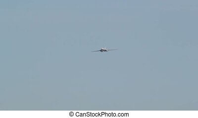 White plane flies in the middle of a clear cloudless sky