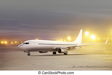 airport at non-flying weather - white plane in airport at...