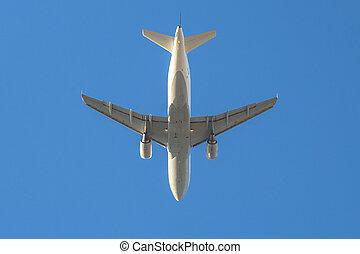 white plane in the sky - white passenger airplane flies...
