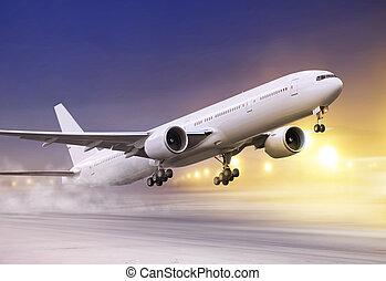 white plane in winter blizzard - airport and white plane...
