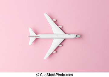 White plane on pink background
