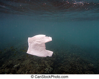 White Plastic Bag floats in the water of the ocean of...