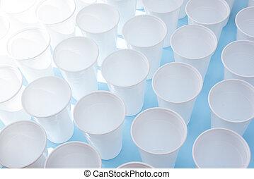 White plastic glasses on blue background
