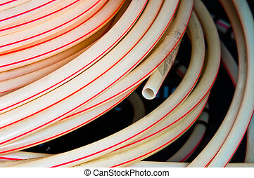 White plastic pipes in a stack