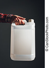 White plastic tank canister in female hand