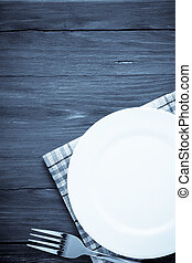 white plate and fork on wood - white plate and fork at...