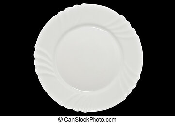 White plate. Isolated on black background - Closeup of white...