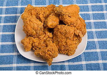 White Plate of Fried Chicken on Blue Plaid Towel