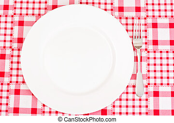 White Plate on a Checkered Tablecloth with Place for Your Text
