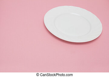 white plate on a pink background