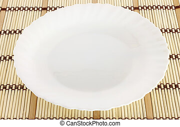 White plate on a wooden background